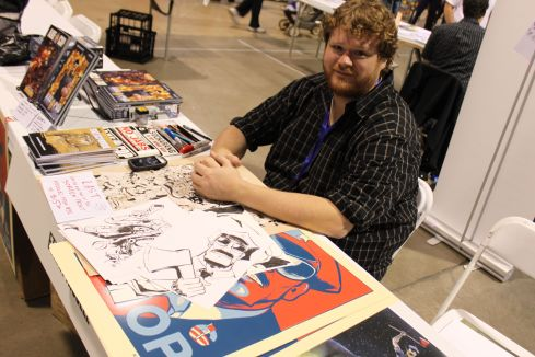 Axe Cop artist Ethan Nicolle at his booth (photo by Orion Tippens)